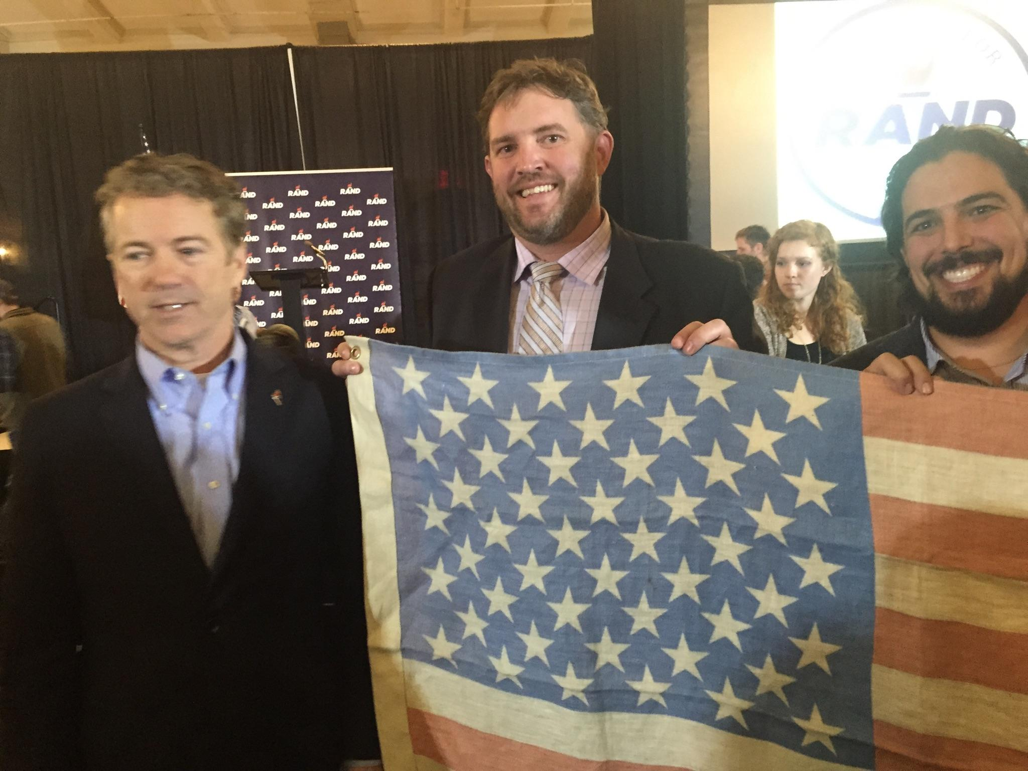 Rick Trojan of the Hemp Road Trip takes a photo with hemp supporter and (at the time) 2016 Republican presidential candidate as they both hold up a Kentucky-made hemp flag. Hemp cultivation is legal in the state of Kentucky. Image Courtesy of The Hemp Road Trip